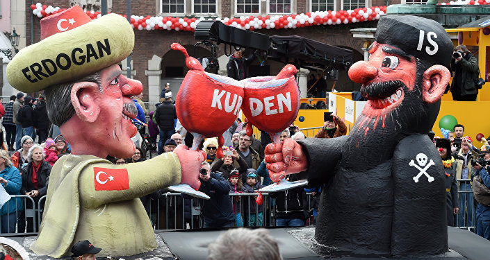 A carnival float depicting Turkish President Recep Tayyip Erdogan (L) clinking his glass with a fighter of the Islamic State (IS) stands in front of the city hall in Duesseldorf, western Germany, after the Rose Monday (Rosenmontag) street parade has been cancelled on February 8, 2016