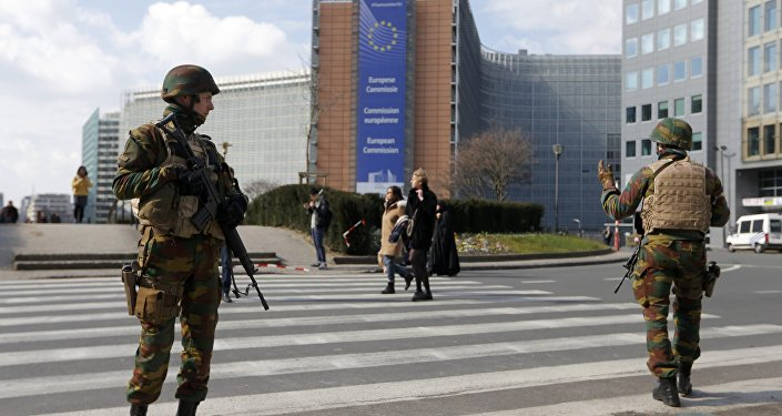 Belgian soldiers patrol outside the European Commission headquarters during high level security alert following the morning explosions in Brussels, Belgium, March 22, 2016