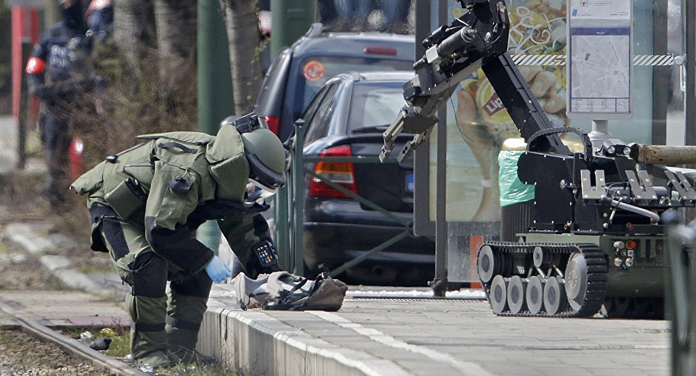 Police use a robotic device as they take part in a search in the Brussels borough of Schaerbeek following Tuesday's bombings in Brussels, Belgium