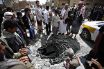 People stand around damages made by a Saudi-led airstrike on a bridge in Sanaa, Yemen, Wednesday, March 23, 2016. Yemen has been left fragmented by war pitting Shiite Houthi rebels and military units loyal to a former president against a US-backed, Saudi-led coalition supporting the internationally recognized government.