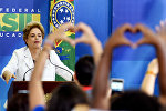 Brazilian President Dilma Rousseff gestures during the Education in Defense of Democracy event, at the Planalto Palace in Brasilia, on April 12, 2016