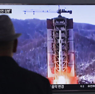 A man watches a TV news program showing a file footage of North Korea's rocket launch at Seoul Railway Station in Seoul, South Korea, Thursday, April 28, 2016.