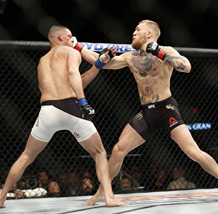 Nate Diaz, left, trades punches with Conor McGregor during their UFC 196 welterweight mixed martial arts match, Saturday, March 5, 2016, in Las Vegas