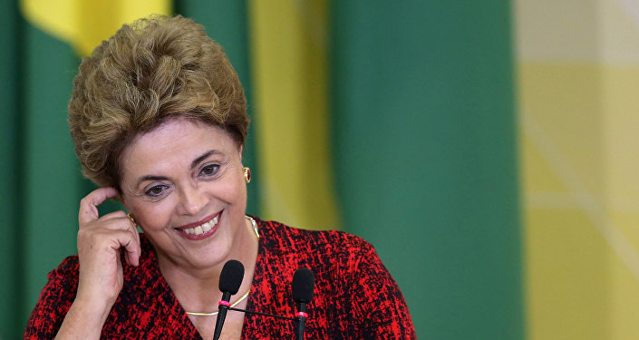Brazil's President Dilma Rousseff smiles as she attends a signing ceremony for new universities at Planalto Palace in Brasilia, Brazil