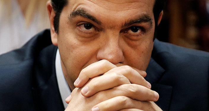 Greek Prime Minister Alexis Tsipras looks on before a ruling Syriza party parliamentary group session in Athens, Greece, May 6, 2016.