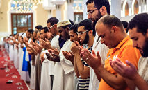 Muslim men praying at a mosque