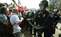 Police push protesters during a rally outside Trump's event in San Diego, California, on May 27, 2016.