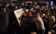 Prostesters clash with the police outside the seized road police building in Yerevan