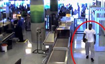 Damarias Cockerham walking through TSA at Dallas-Fort Worth International Airport