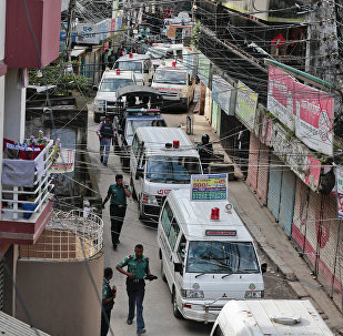 Ambulances carrying bodies of killed suspected Islamic militants leave the premises of a five-story building that was raided by police in Dhaka, Bangladesh, Tuesday, July 26, 2016
