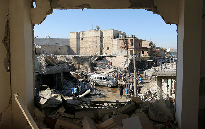 People inspect a site hit by airstrikes in the rebel held town of Atareb in Aleppo province, Syria, July 25, 2016