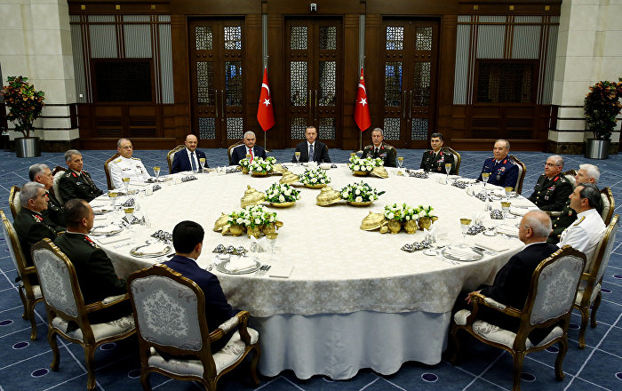 Turkey's President Tayyip Erdogan (C) meets with Turkey's Prime Minister Binali Yildirim (8th L), Chief of Staff General Hulusi Akar (7th R) and the members of High Military Council around a dinner table at the Presidential Palace in Ankara, Turkey, July 28, 2016