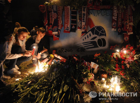 Flowers and candles in memory of Lokomotiv hockey players