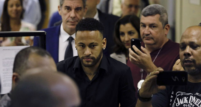 Brazilian soccer player Neymar leaves police headquarters in Rio de Janeiro, Brazil, Thursday, June 6, 2019. Neymar went to the headquarters in an investigation linked to a woman's rape allegation against him