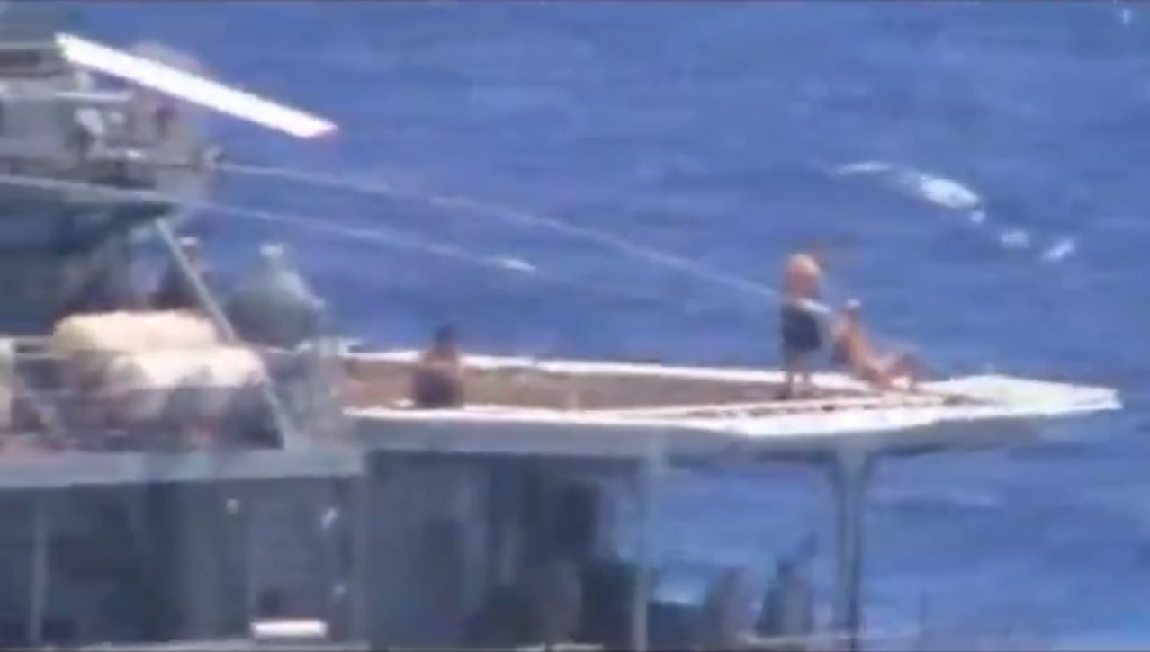 Russian sailors allegedly taking sunbath on helicopter pad of Russian Udaloy-class destroyer Admiral Vinogradov