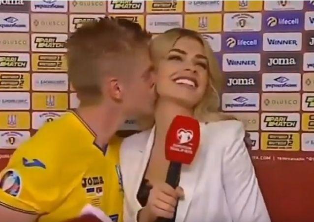Oleksandr Zinchenko kissing reporter