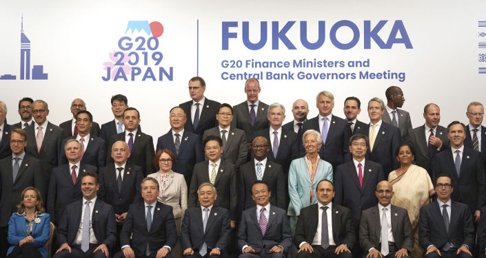 Participants attend a family photo session of the G20 finance ministers and central bank governors meeting