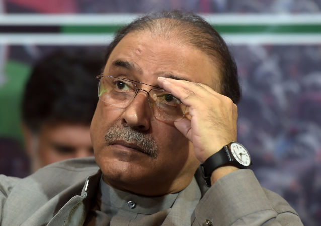 Former Pakistani president Asif Ali Zardari listens to his son and chairman of the Pakistan Peoples Party (PPP) Bilawal Bhutto Zardari (unseen) during the party manifesto presentation for the forthcoming general election during a press conference in Islamabad on June 28, 2018