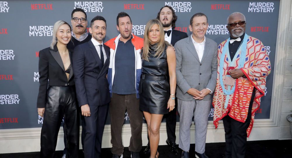 LOS ANGELES, CALIFORNIA - JUNE 10: (L-R) Shiori Kutsuna, Erik Griffin, Luis Gerardo Mendez, Adam Sandler, Jennifer Aniston, Kyle Newacheck, Dany Boon and Dr. John Kani attend the Netflix World Premiere Of Murder Mystery at Village Theatre Westwood on June 10, 2019 in Los Angeles, California