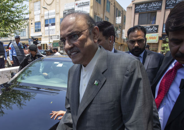 Former Pakistani president and currently a lawmaker in Parliament and leader of Pakistan People's party, Asif Ali Zardari, center, leaves the High Court building, in Islamabad, Pakistan, Monday, June 10, 2019