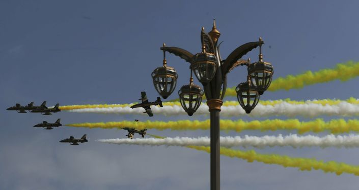 Al Fursan, or the Knights, a UAE Air Force aerobatic display team, perform as they make the colors of the Vatican flag ahead of Pope Francis arrival at the Abu Dhabi Presidential Palace, United Arab Emirates, Monday, Feb. 4, 2019