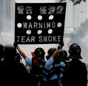 Police officer holds a sign during a demonstration against a proposed extradition bill in Hong Kong, China June 12, 2019.