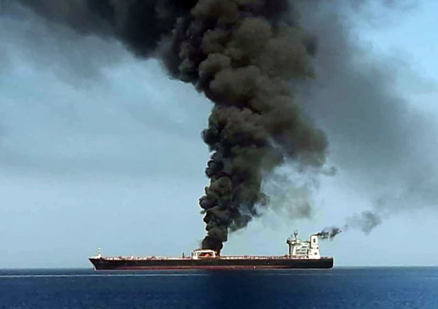 A picture obtained by AFP from Iranian State TV IRIB on June 13, 2019 reportedly shows smoke billowing from a tanker said to have been attacked off the coast of Oman, at un undisclosed location