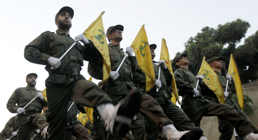 FILE - In this Nov. 12, 2010 file photo, Hezbollah fighters parade during the inauguration of a new cemetery for their fighters who died in fighting against Israel, in a southern suburb of Beirut, Lebanon