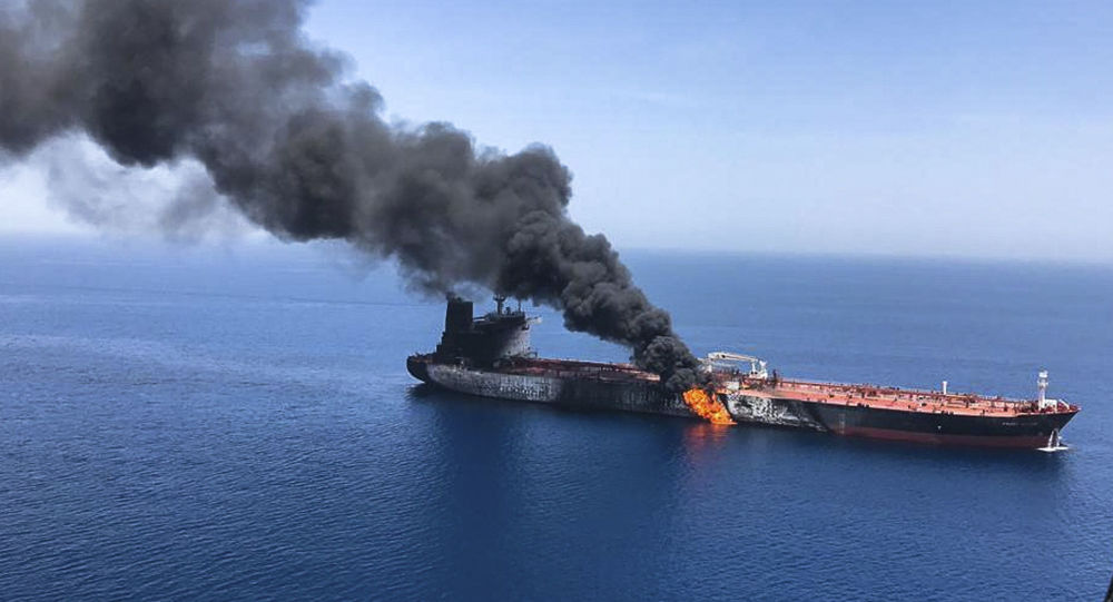 An oil tanker is on fire in the sea of Oman, Thursday, June 13, 2019