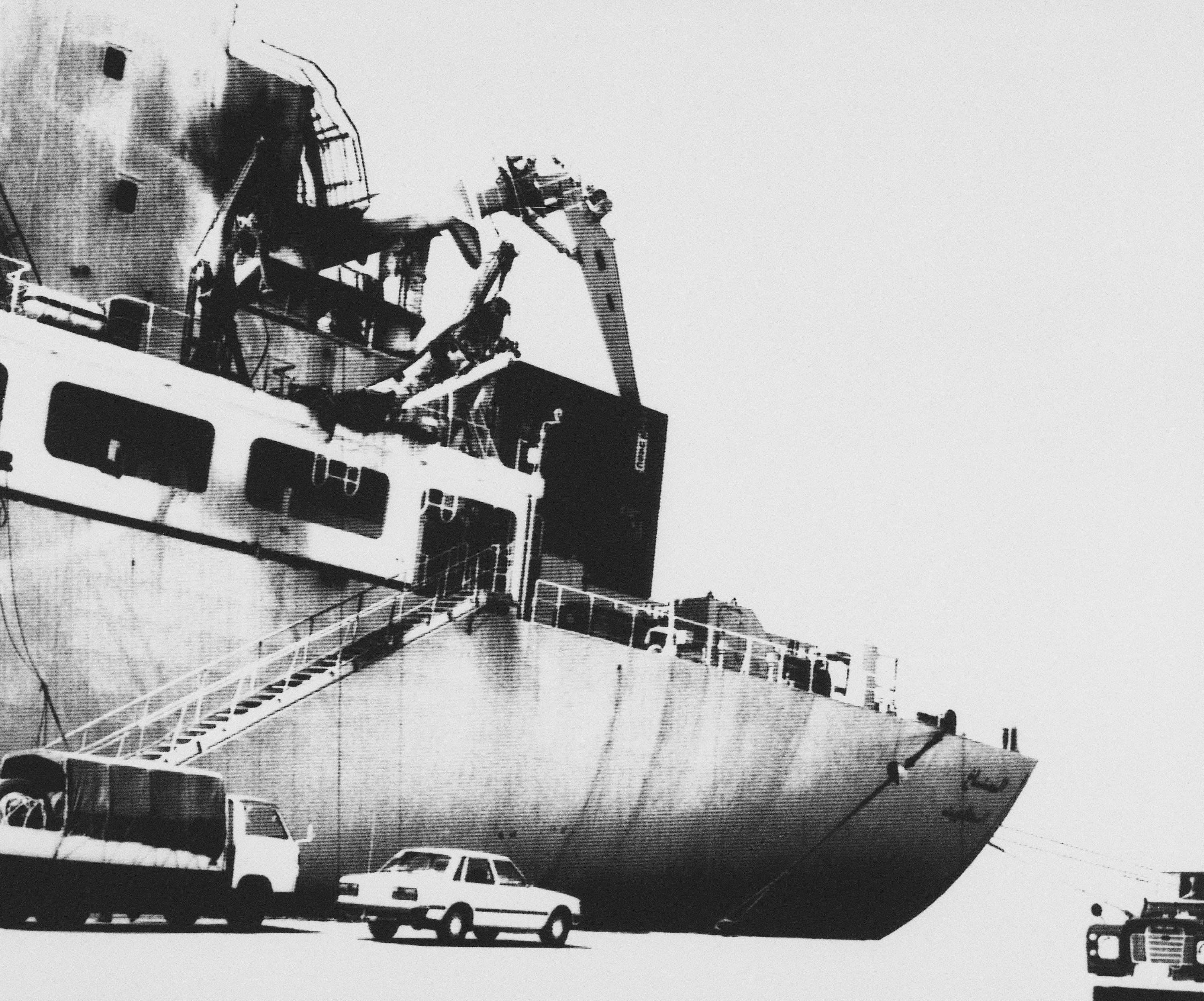 View of the soot-covers Kuwaiti registered countainer ship Al-Manakh at the Dubai port on Feb. 19, 1985 where it will be repaired. The vessel was damaged in an Iran air attack in the gulf waters Monday.