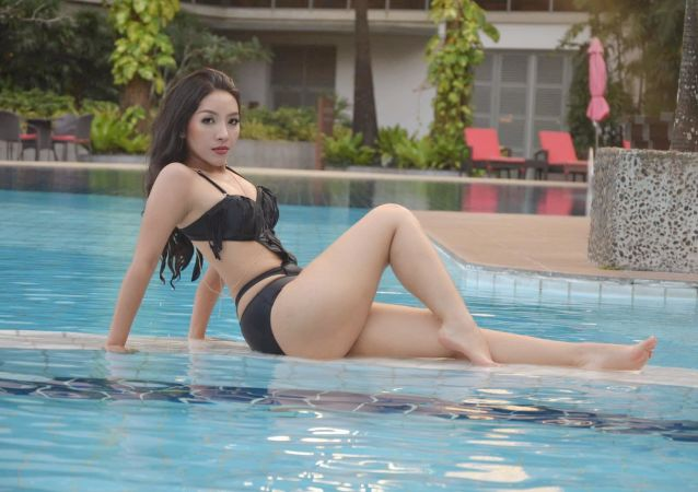 Model and Doctor Nang Mwe San poses poolside in a photo uploaded to Facebook on January 18, 2019.