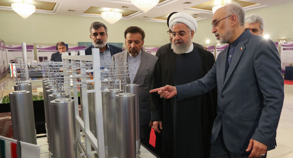 Iranian President Hassan Rouhani (2nd L) listening to head of Iran's nuclear technology organisation Ali Akbar Salehi (R) during the nuclear technology day in Tehran