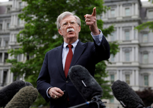 US national security adviser John Bolton talks to reporters at the White House
