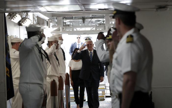 Vice President Mike Pence salutes as he arrives for a tour on the USNS Comfort, Tuesday, June 18, 2019, in Miami. The hospital ship is scheduled to embark on a five-month medical assistance mission to Latin America and the Caribbean, including several countries struggling to absorb migrants from crisis-wracked Venezuela. (AP Photo/Lynne Sladky)