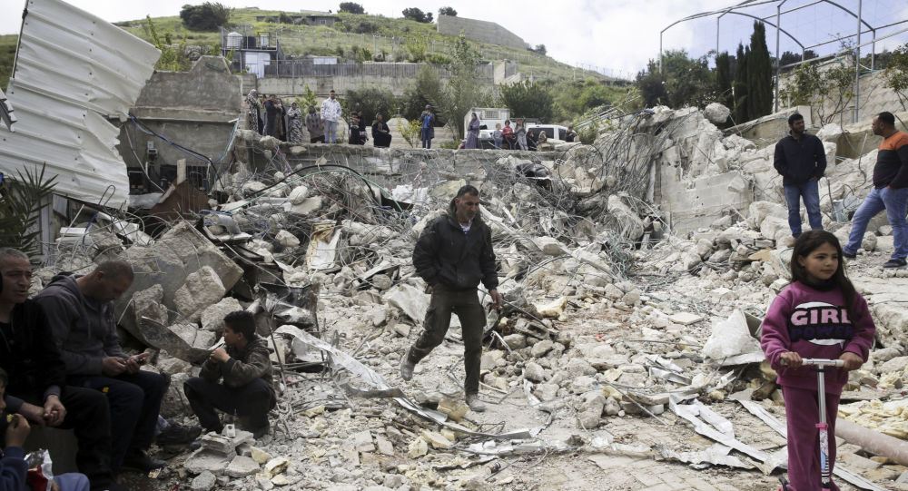 Palestinians watch a family house destroyed by Israeli authorities in east Jerusalem's neighbourhood of Silwan on 17 April 2019