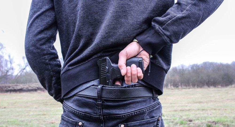 Man pulls handgun from waistband