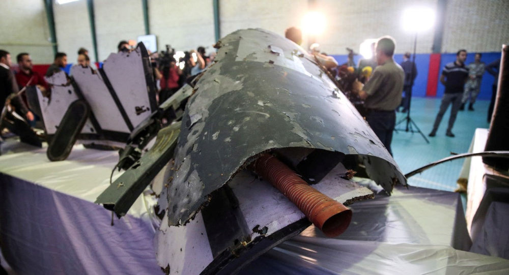 The purported wreckage of the American drone is seen displayed by the Islamic Revolution Guards Corps (IRGC)