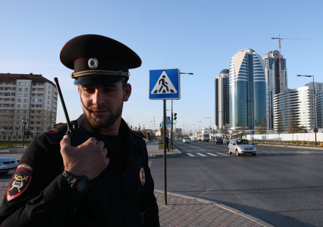 A police officer patrolling the streets in the city of Grozny