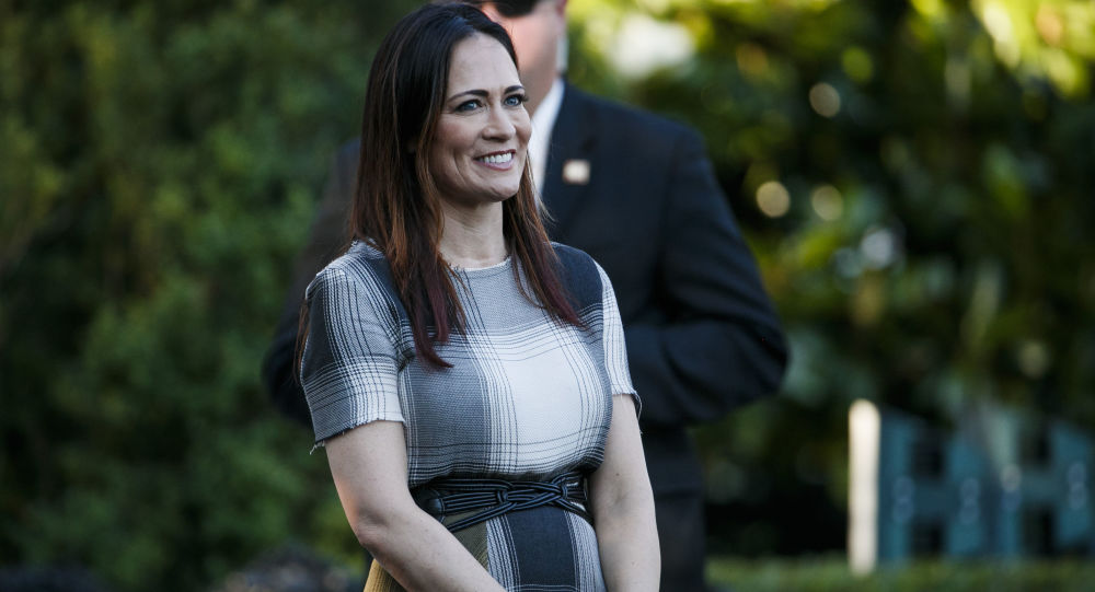 Stephanie Grisham, spokeswoman for first lady Melania Trump, watches as President Donald Trump and the first lady greet attendees during the annual Congressional Picnic on the South Lawn, Friday, June 21, 2019, in Washington.