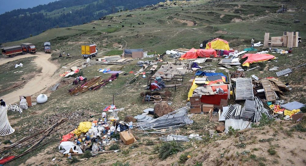 A general view shows waste left behind following the large-scale weddings of the brothers Suryakant and Shashank Gupta of the South Africa-based Gupta family, following days of celebrations in the Auli hill station in Uttarakhand state on June 24, 2019