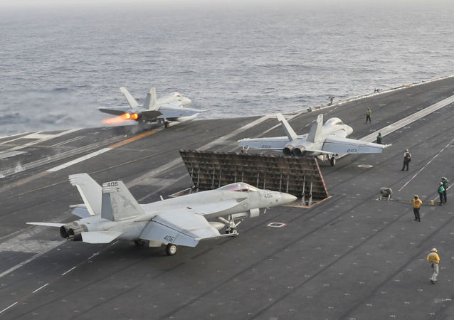 An F/A-18E Super Hornet launches from the flight deck of the Nimitz-class aircraft carrier USS Abraham Lincoln, in Arabian Sea, June 22, 2019