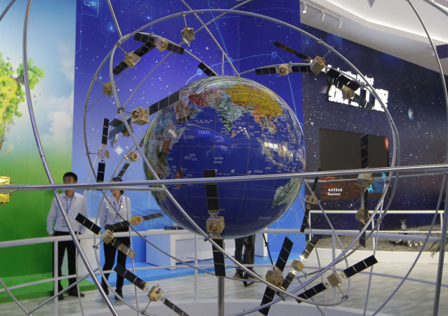 FILE - In this file photo taken Tuesday, Nov. 6, 2018, a model of Chinese BeiDou navigation satellite system is displayed during the 12th China International Aviation and Aerospace Exhibition, also known as Airshow China 2018, in Zhuhai city, south China's Guangdong province
