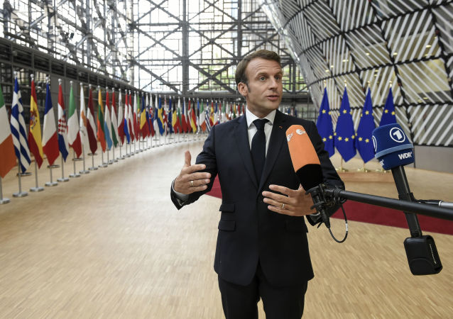 France's President Emmanuel Macron speaks to the press as he arrives for an European Council Summit at The Europa Building in Brussels, on June 30, 2019