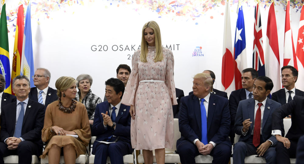 Ivanka Trump stands up to speak at the President G-20 summit event on women's empowerment in Osaka, Japan, in Osaka, Japan, Saturday, June 29, 2019. President Donald Trump, center right, also attends.