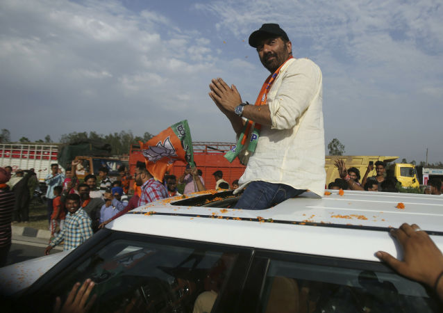 Bollywood actor and India's ruling Bharatiya Janata Party (BJP) candidate Sunny Deol greets people during an election campaign road show at Dinanagar in northern state of Punjab, India, Thursday, May 2, 2019
