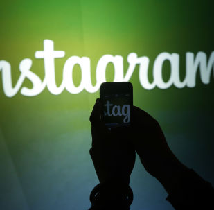 A journalist makes a video of the Instagram logo using the new video feature at Facebook headquarters in Menlo Park, Calif., Thursday, June 20, 2013