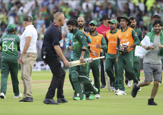 Pakistani cricketers celebrate their team's victory in the Cricket World Cup match between Pakistan and Afghanistan at Headingley in Leeds, England, Saturday, June 29, 2019