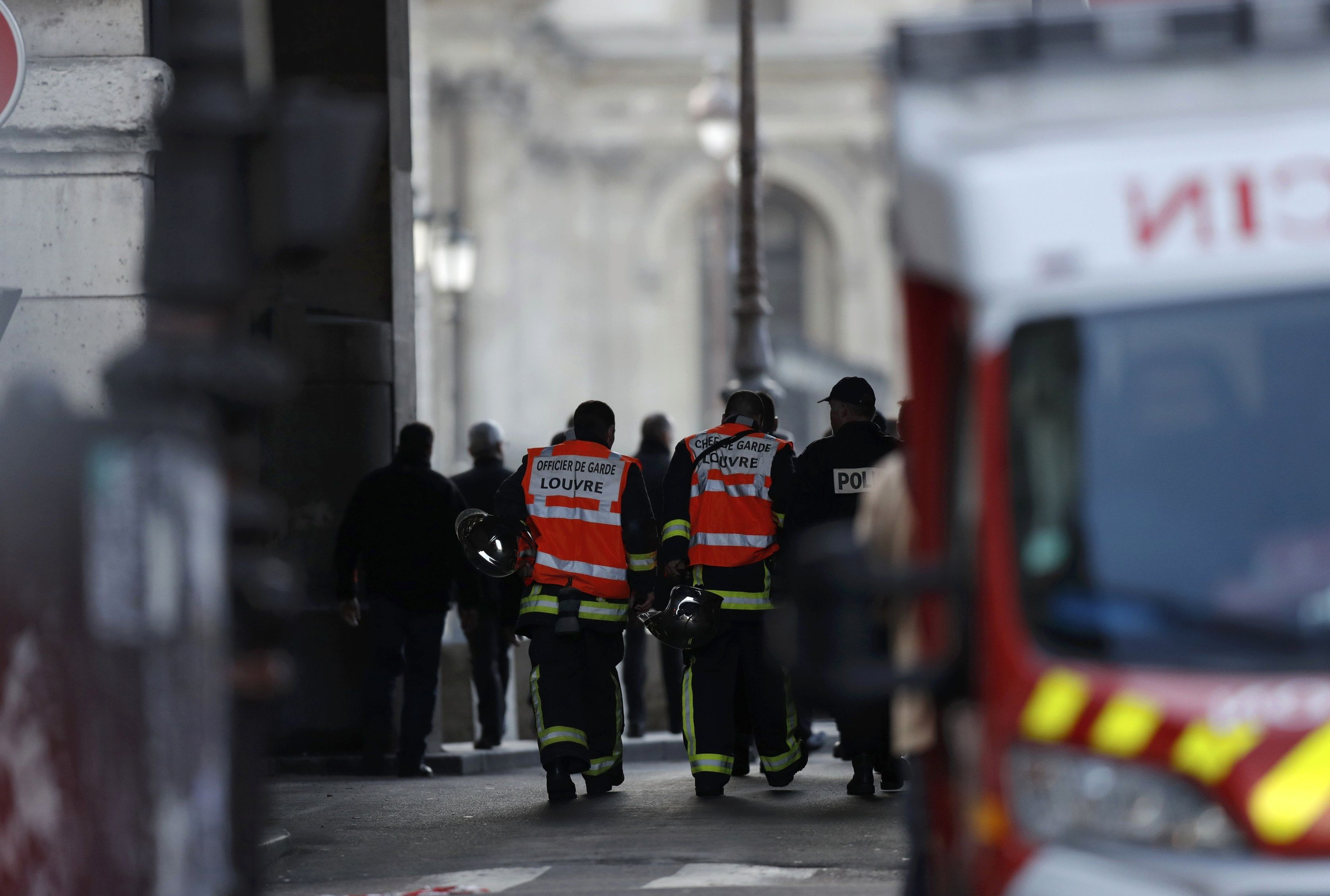 French firefighters and police are seen at the site near the Louvre Pyramid in Paris, France, February 3, 2017 after a French soldier shot and wounded a man armed with a knife after he tried to enter the Louvre museum in central Paris carrying a suitcase, police sources said.