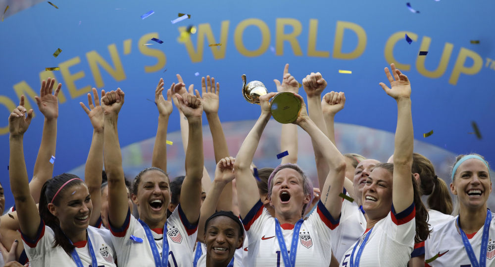 United States' Megan Rapinoe lifts up a trophy after winning the Women's World Cup final soccer match between US and The Netherlands at the Stade de Lyon in Decines, outside Lyon, France, Sunday, July 7, 2019. (AP Photo/Alessandra Tarantino)