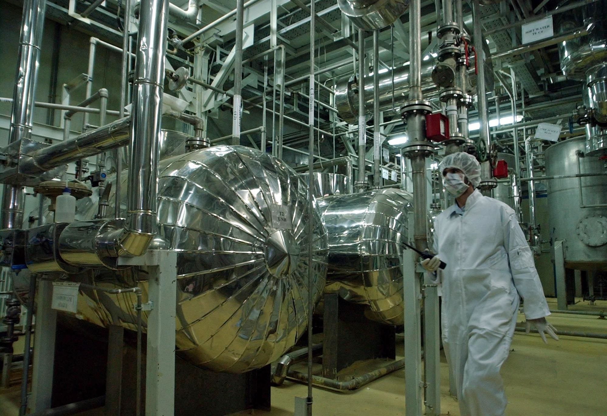 An Iranian security official, dressed in protective clothing, walks inside the Uranium Conversion Facility, just outside the city of Isfahan, 410 kilometers, (255 miles), south of the Iranian capital Tehran in this Wednesday, March 30, 2005